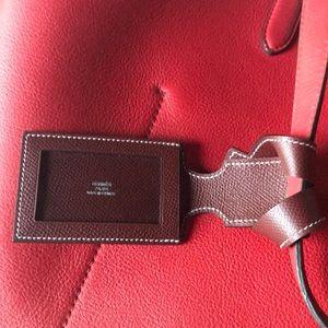Hermès luggage tag with original box, never used